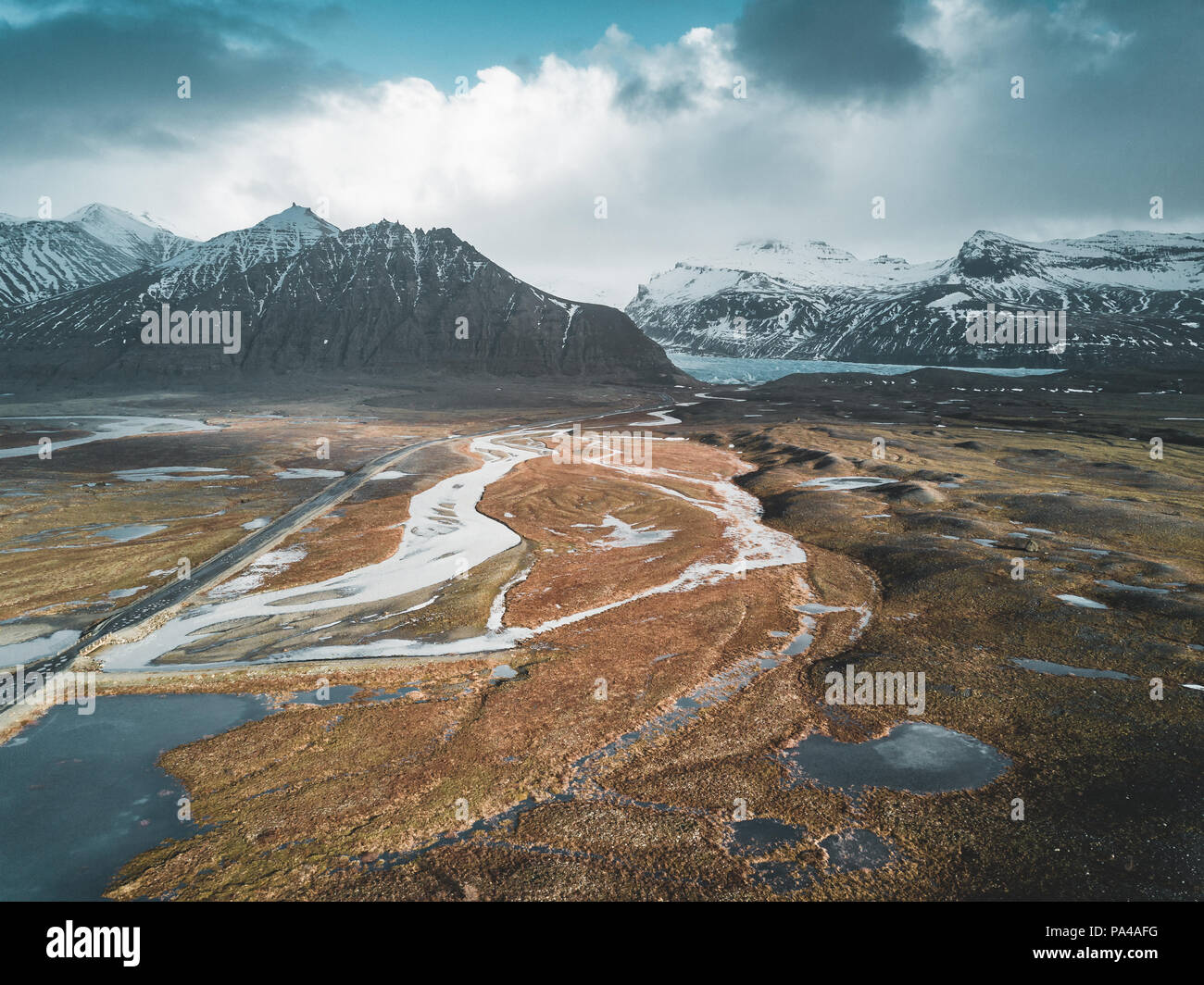 Vatnajokull glacier aerial drone image with street highway and clouds and blue sky. Dramatic winter scene of Vatnajokull National Park, Iceland, Europe. Beauty of nature concept background. - Stock Image