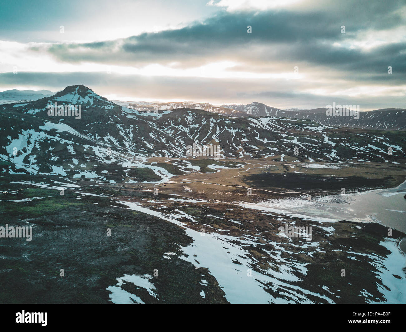 Aerial drone photo of a empty lake a huge volcanic mountain Snaefellsjokull in the distance, Reykjavik, Iceland. - Stock Image
