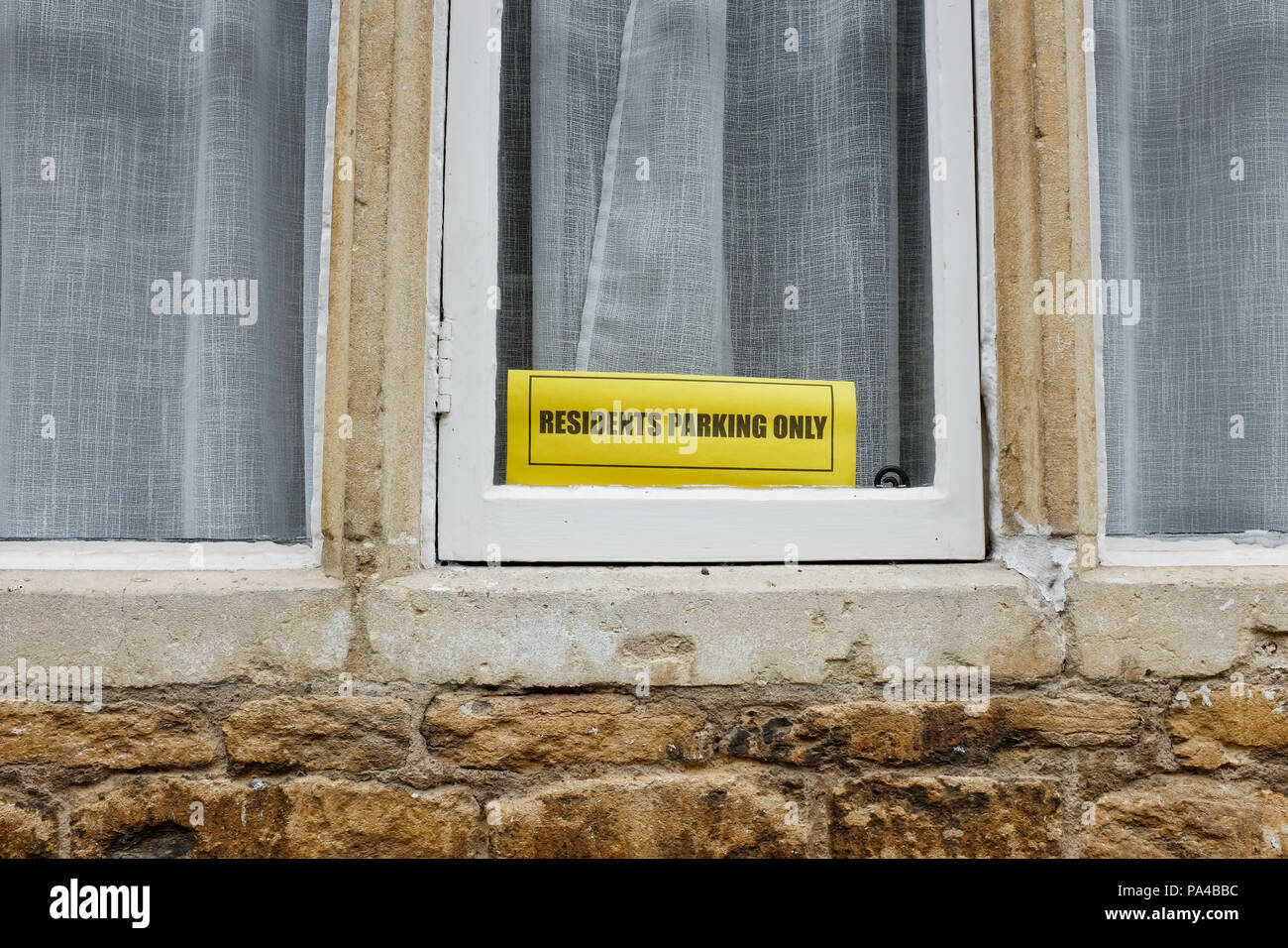 A 'residents parking only' sign in the Wiltshire village of Lacock, England. - Stock Image