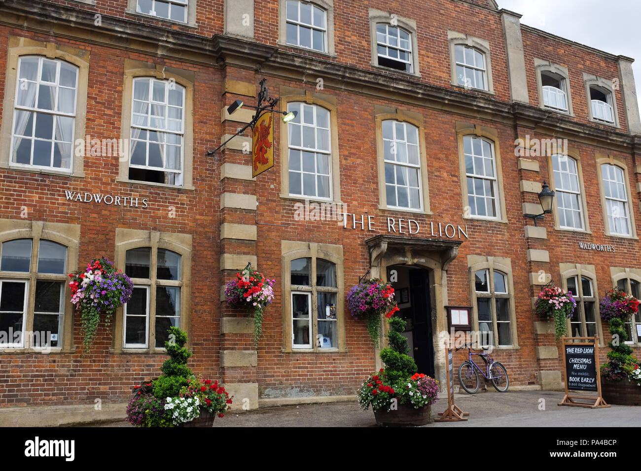The Red Lion pub in the village of Lacock in Wiltshire, England. - Stock Image