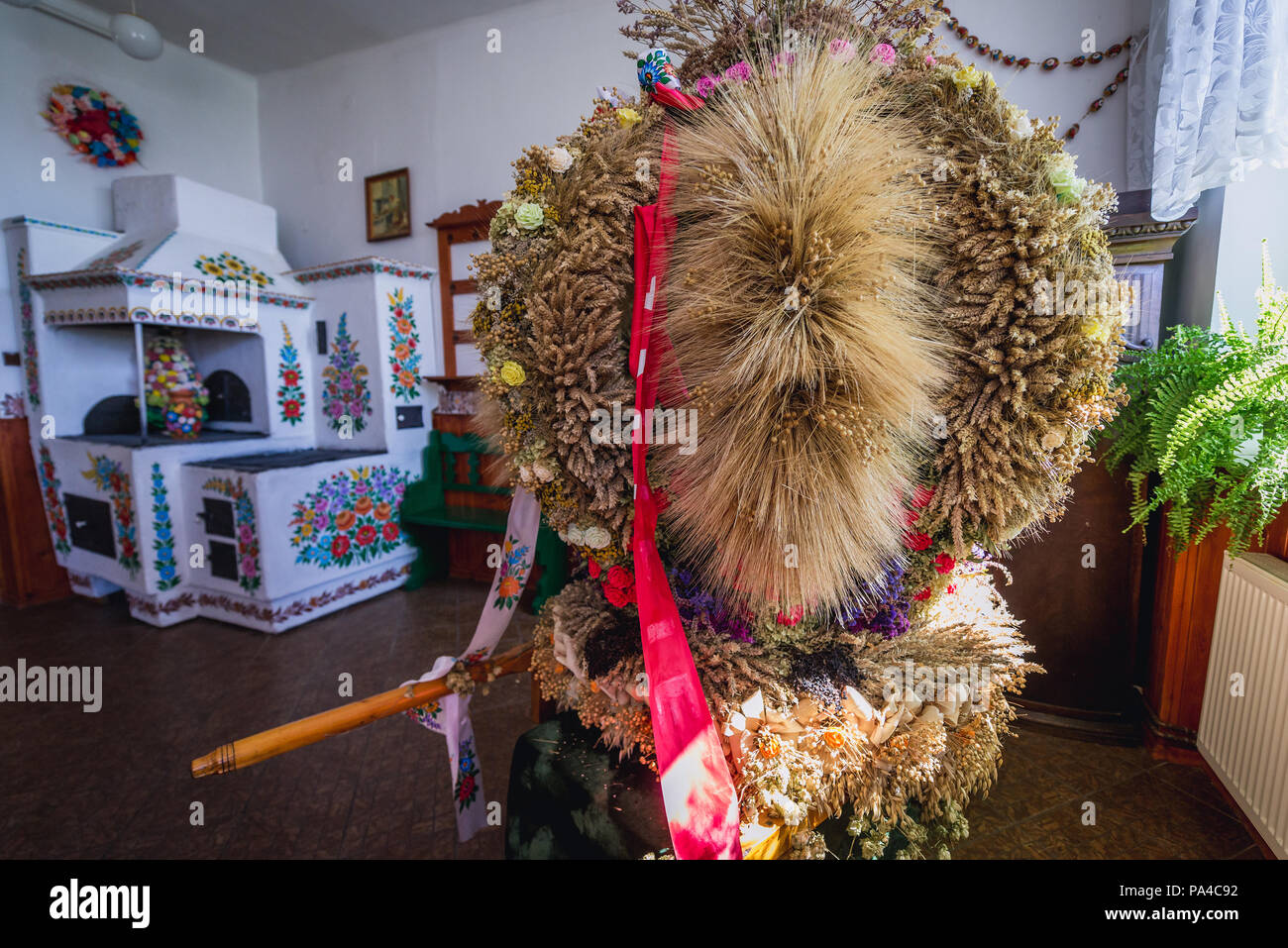 Wreath for harvest fstival in community centre called House of Painters in Zalipie, Poland, famous for its local tradition of floral paintings - Stock Image