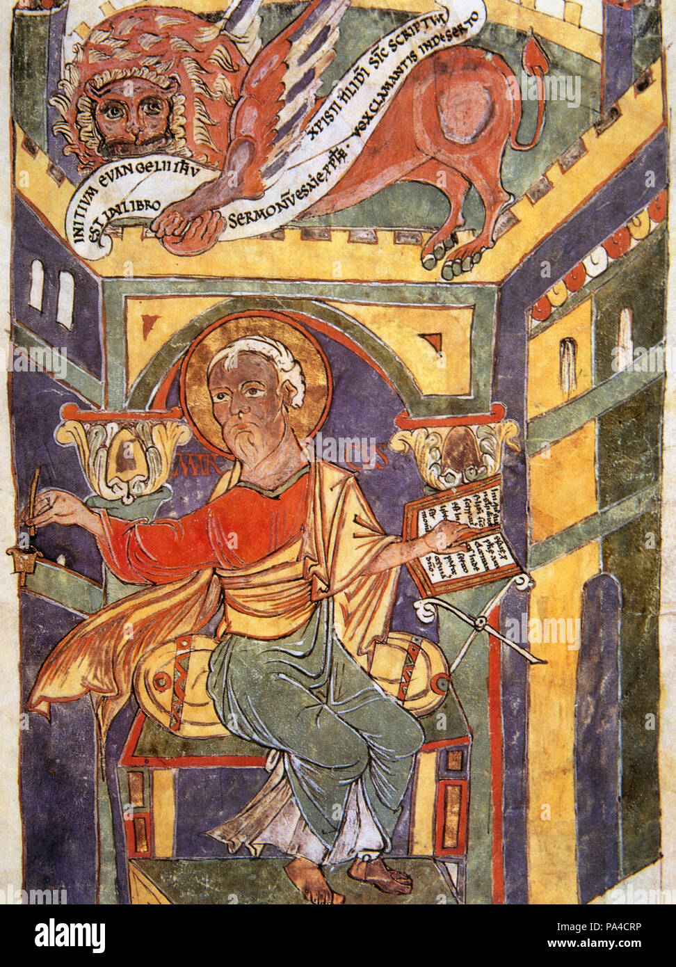 Saint Mark the Evangelist. Miniature, 11th century. 'The Book of the Gospel', St. Mark is depicted writing the second gospel, accompanied by the symbol of the tetramorph: the winged lion. Vatican Apostolic Library. Vatican City. - Stock Image