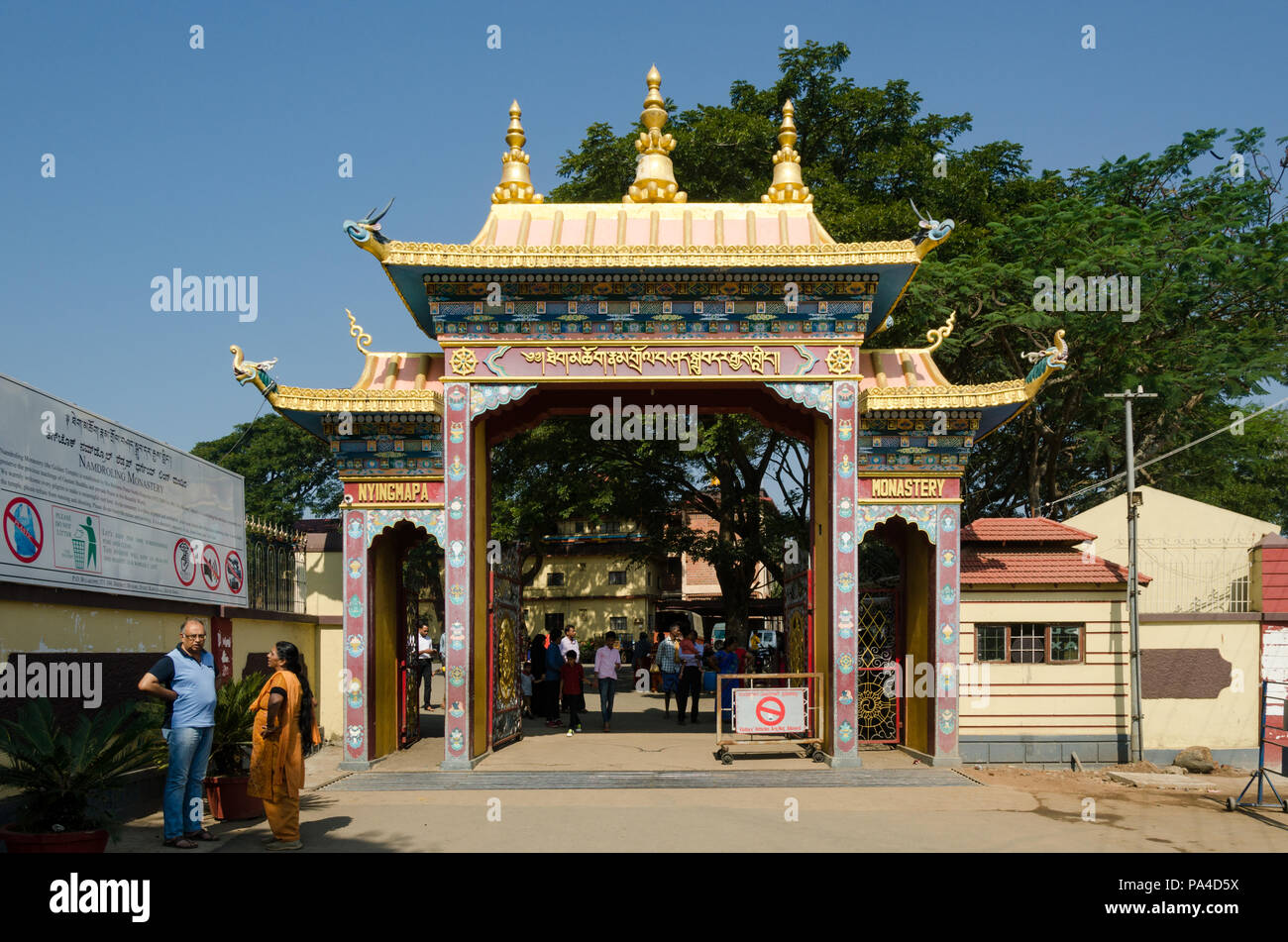 Entrance gate of the Namdroling Monastery in Mysore district, Karnataka, India - Stock Image