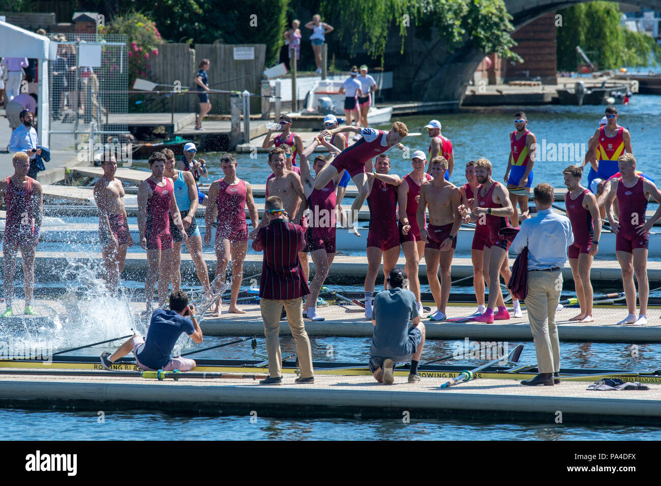"Henley on Thames, United Kingdom, 8th July 2018, Sunday, ""The Ladies Challenge Plate"", Oxford Brookes University, Celebrating, winning the final, jumping into the water between the pontoons,  ""Fifth day"", of the annual,  ""Henley Royal Regatta"", Henley Reach, River Thames, Thames Valley, England, © Peter SPURRIER, Stock Photo"