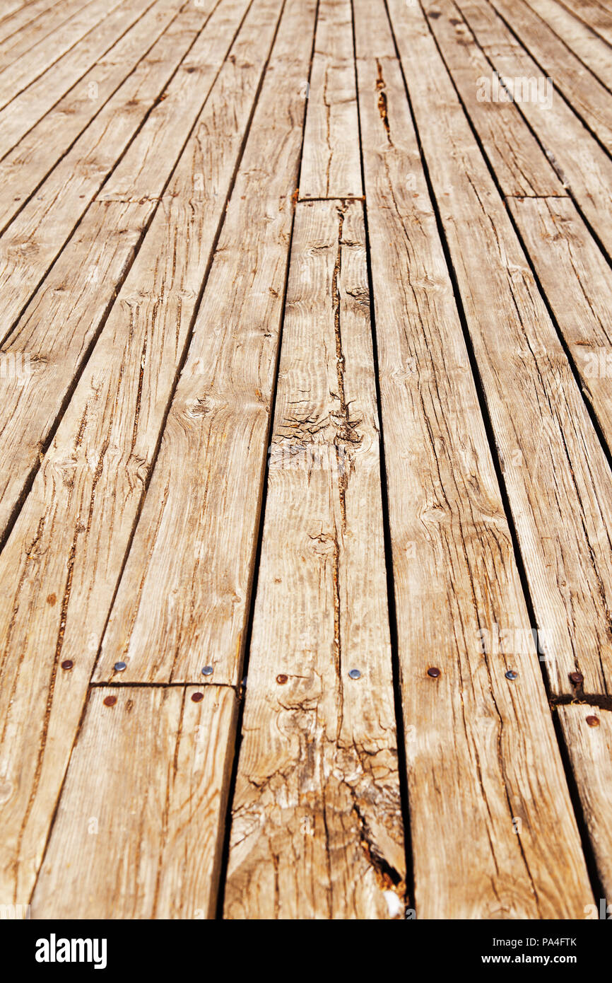 Closeup of wooden planks of fence, boardwalk, texture background. Vertical diagonal lines - Stock Image