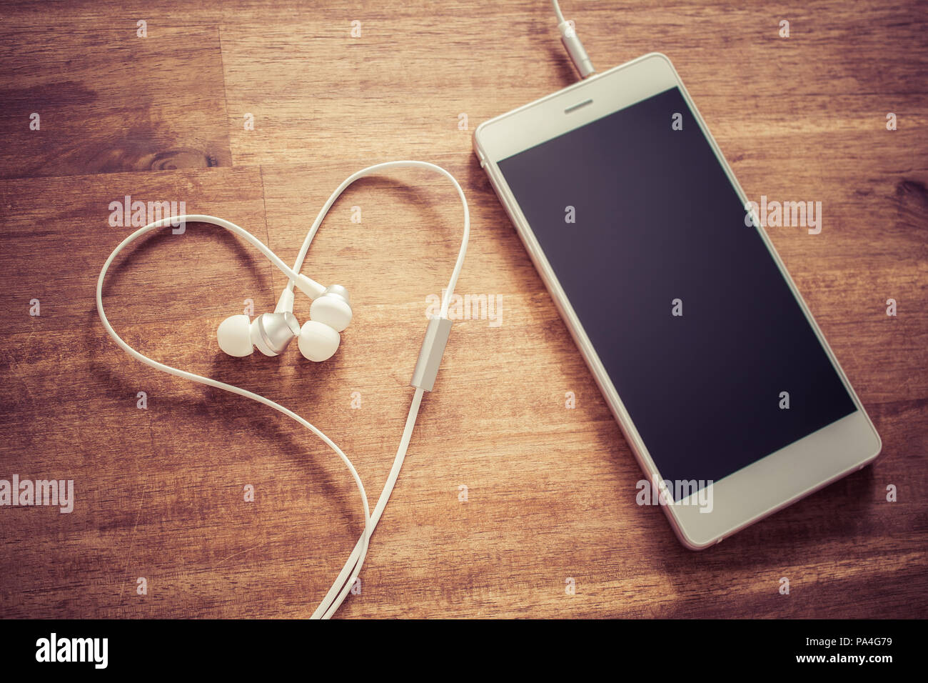 Love Listening Music Concept With White Mobile Phone And A Heart Shaped Headset Stock Photo Alamy