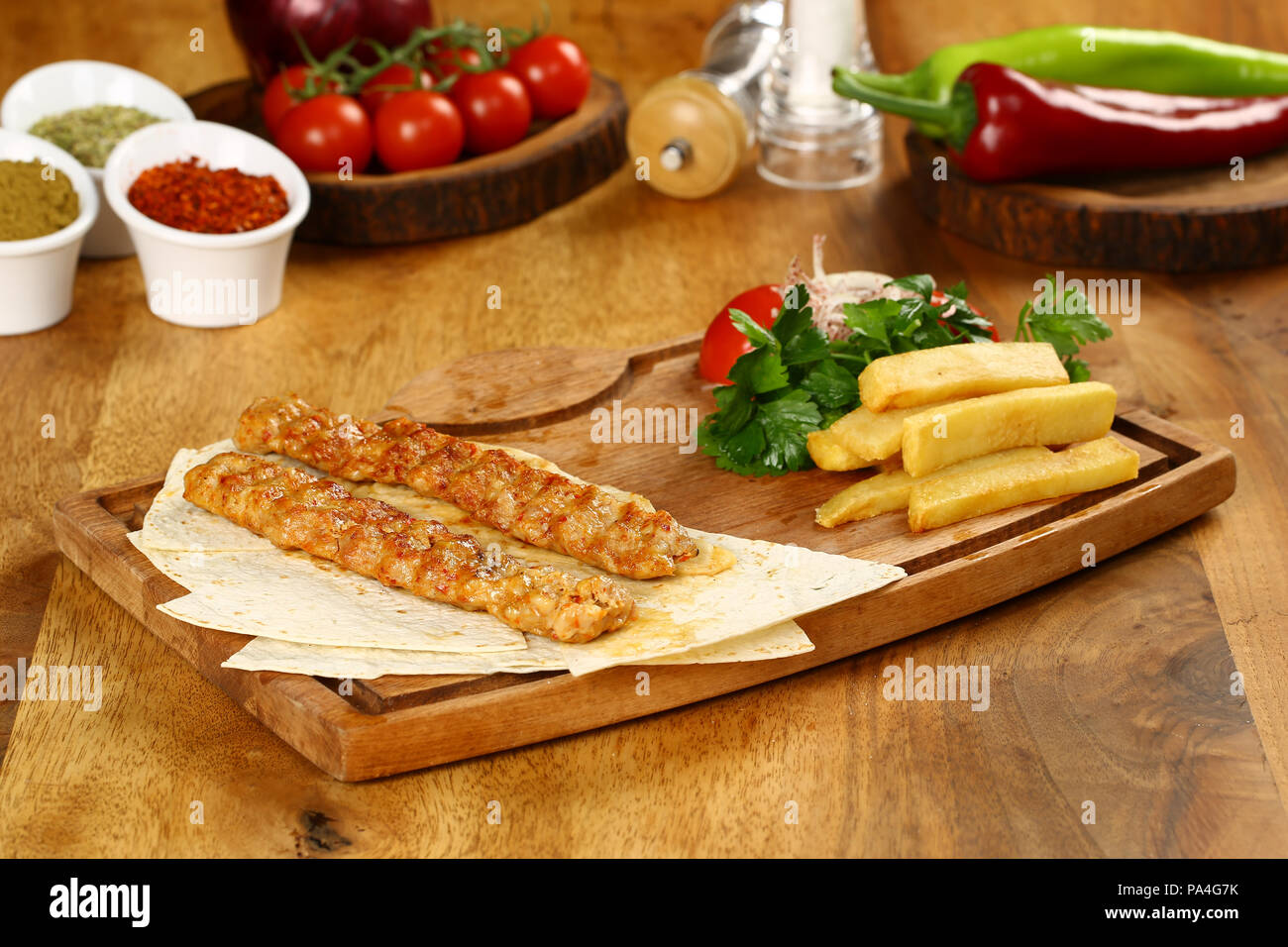 Chicken Adana kebap served with lavash Stock Photo