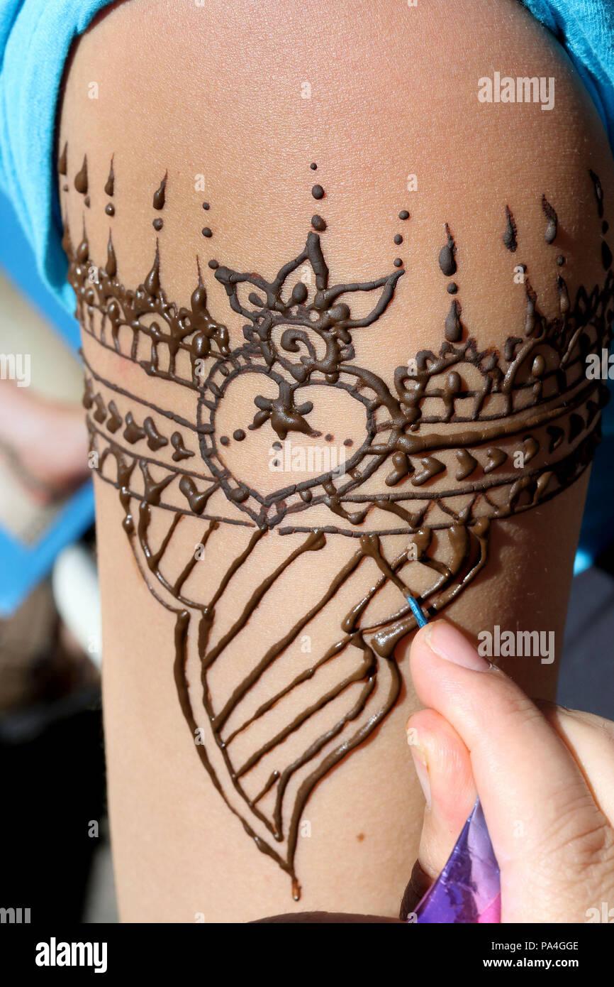 Henna tattoo on forearm - Stock Image