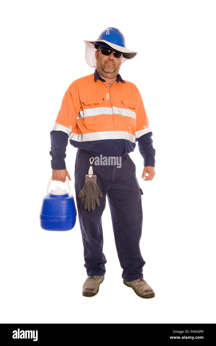 A mine worker with a wide brimmed hat and water bottler for safety in hot environments. - Stock Image