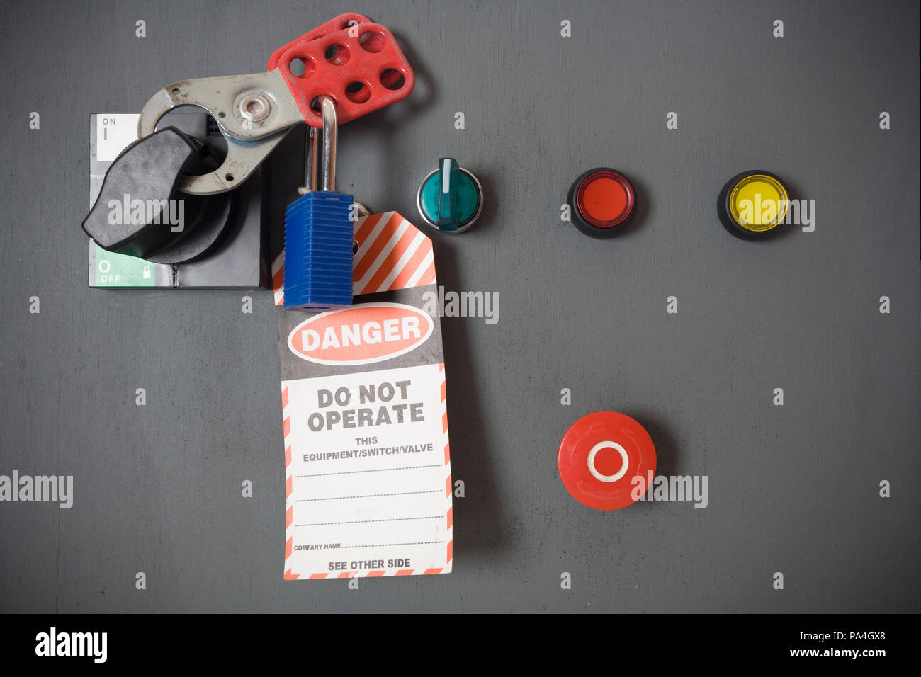 A motor control panel turned off and tagged out with a danger tag. - Stock Image