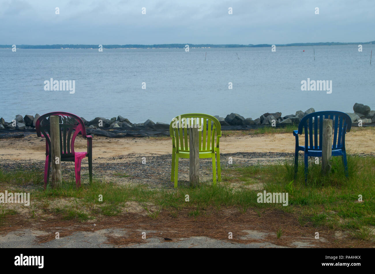 Three chairs stand ready for use in a campground in Delaware - Stock Image