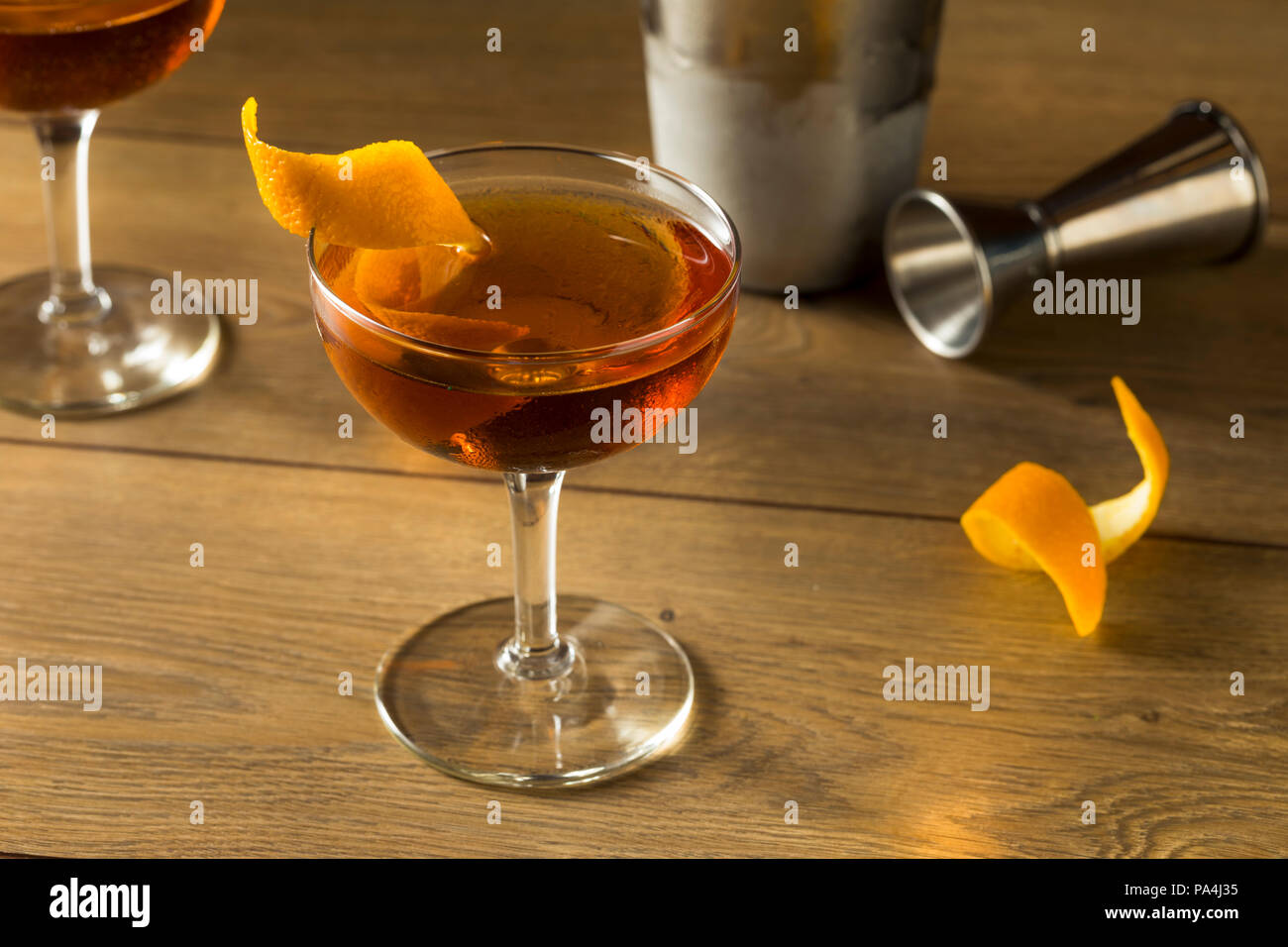 Alcoholic Martinez Cocktail with Gin Vermouth and Orange Peel - Stock Image
