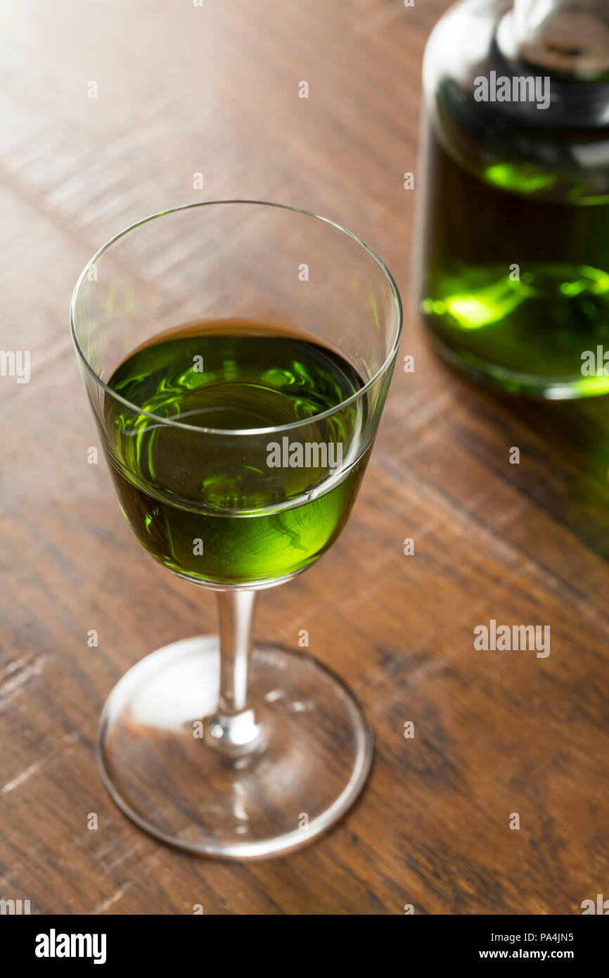 Alcoholic Green Absinth Apertif in a Bottle for Cocktails Stock Photo