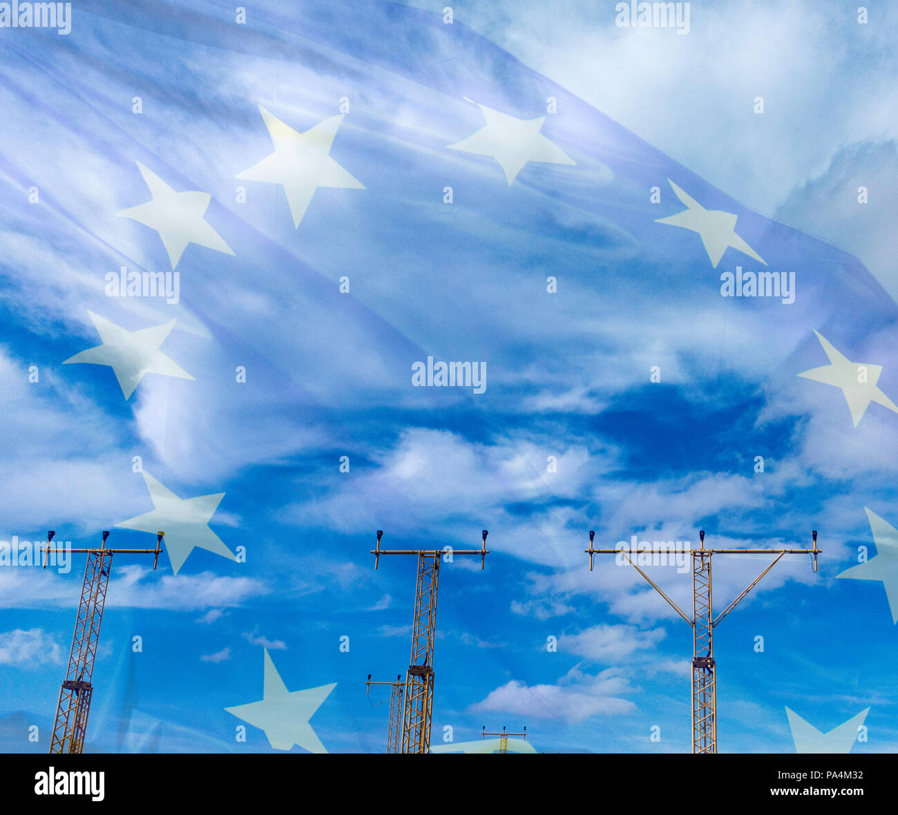 European Union flag blended with sky above airport. EU/UK/Irish border Brexit, immigration...concept. - Stock Image