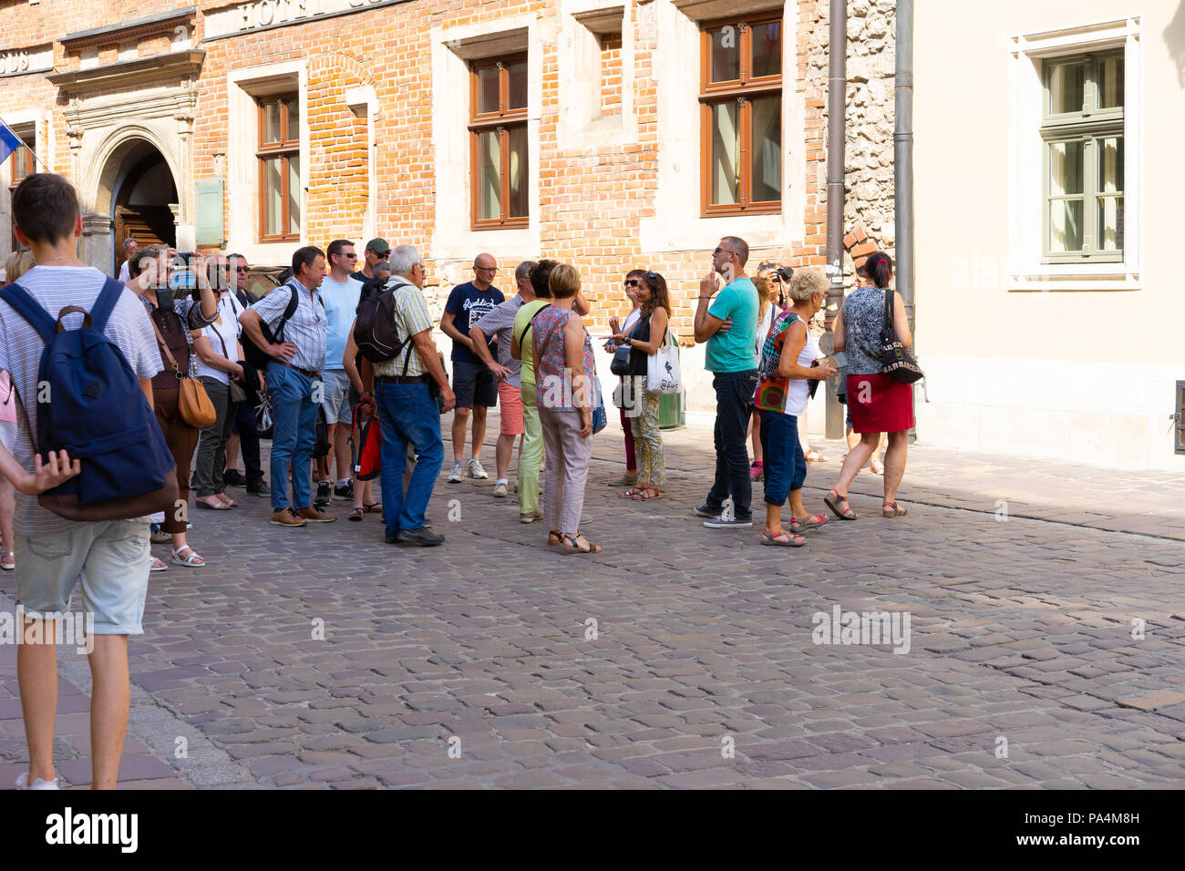 Group of tourists on a guided tour, Krakow, Poland, Europe. - Stock Image