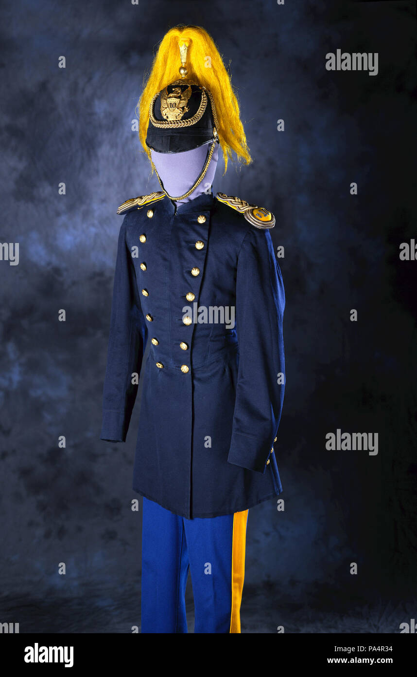 . English: The 10th U.S. Cavalry, a regiment of African American soldiers, served with distinction in Cuba as part of the force that captured San Juan with Teddy Roosevelt's Rough Riders during the Spanish-American War. The uniform helmet, trousers and coat belonged to Lt. William Harvey Smith, who was killed during the battle. Title: Dress Uniform Helmet, Trousers and Coat of Lt. William Harvey Smith, Tenth U.S. Cavalry . between 1883 and 1898 592 Dress Uniform Helmet, Trousers and Coat of Lt. William Harvey Smith, Tenth U.S. Cavalry - Stock Image