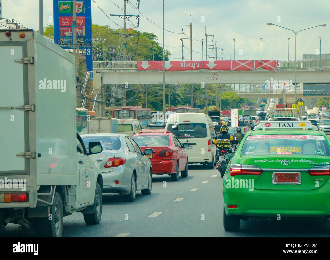 BANGKOK, THAILAND - MAY 9, 2018: Traffic moves slowly along a busy road in Bangkok, Thailand. Stock Photo