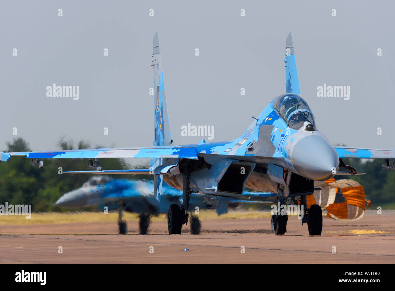 Ukrainian Air Force Sukhoi Su27 Flanker fighter jets taxiing in at the Royal International Air Tattoo RIAT 2018 RAF Fairford, UK. Dragging brake chute - Stock Image