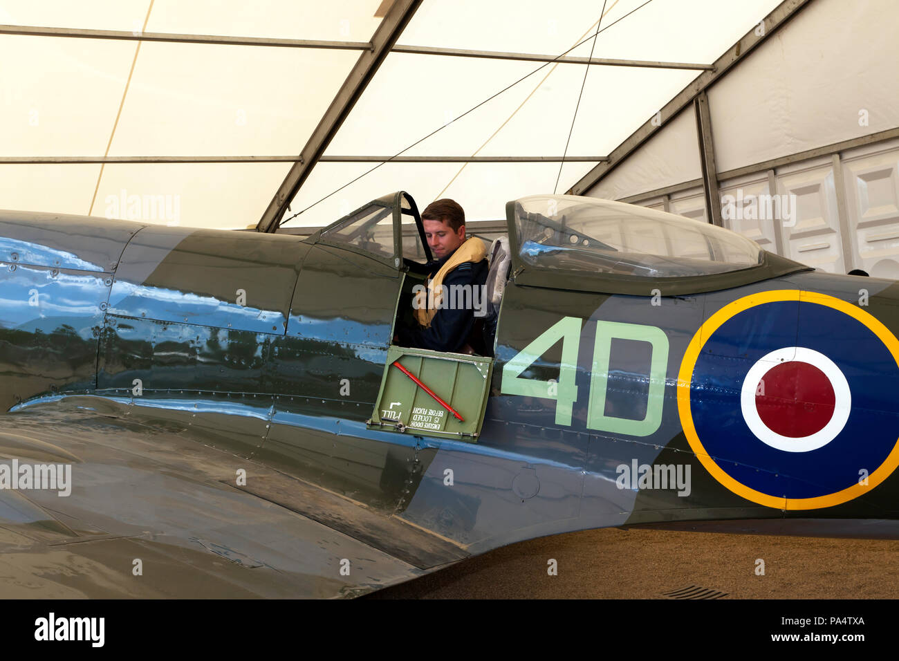 Man in period pilots uniform, poses in the cockpit of a  Supermarine Spitfire Mk XVI, part of the RAF Centennial Celebrations at Horse Guards Parade, - Stock Image