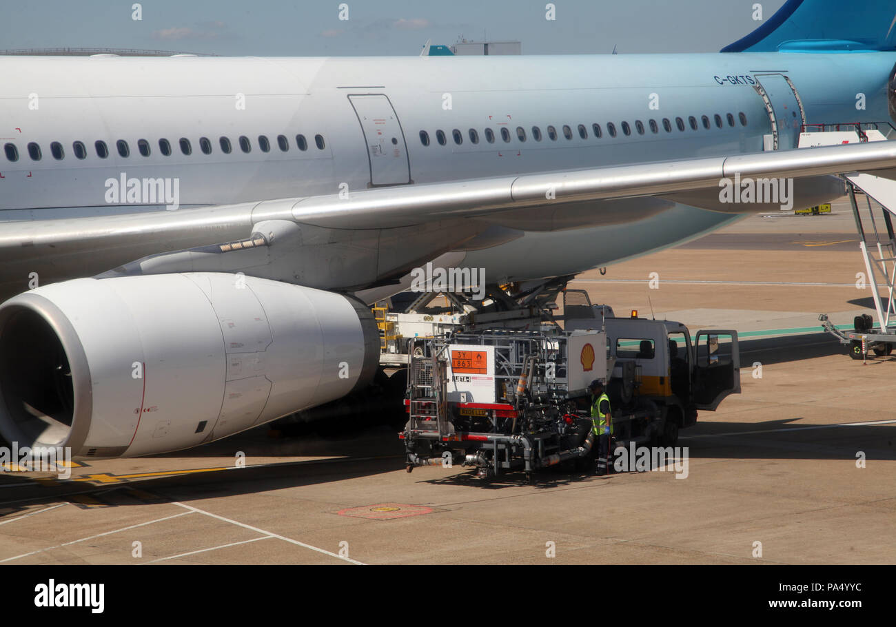 an aircraft being refuelled at London Gatwick Airport - Stock Image