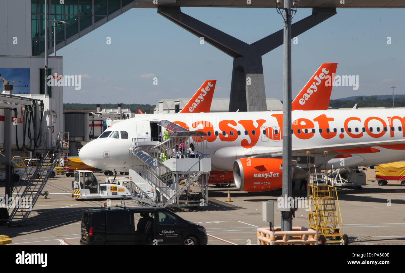 people boarding an EasyJet plane on the apron at London Gatwick Airport, UK - Stock Image