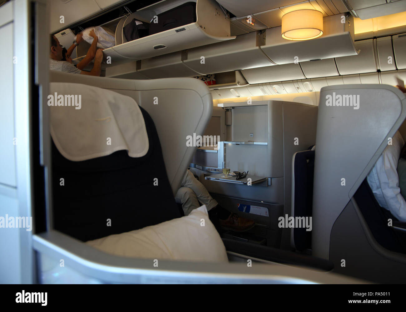 on board a BA flight, the view of club class (business class) seats on board a Boeing 777, UK - Stock Image