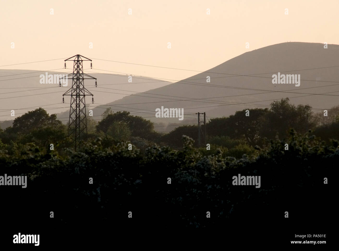Pylons and power lines near Mount Caburn in the the South Downs National Park, UK - Stock Image