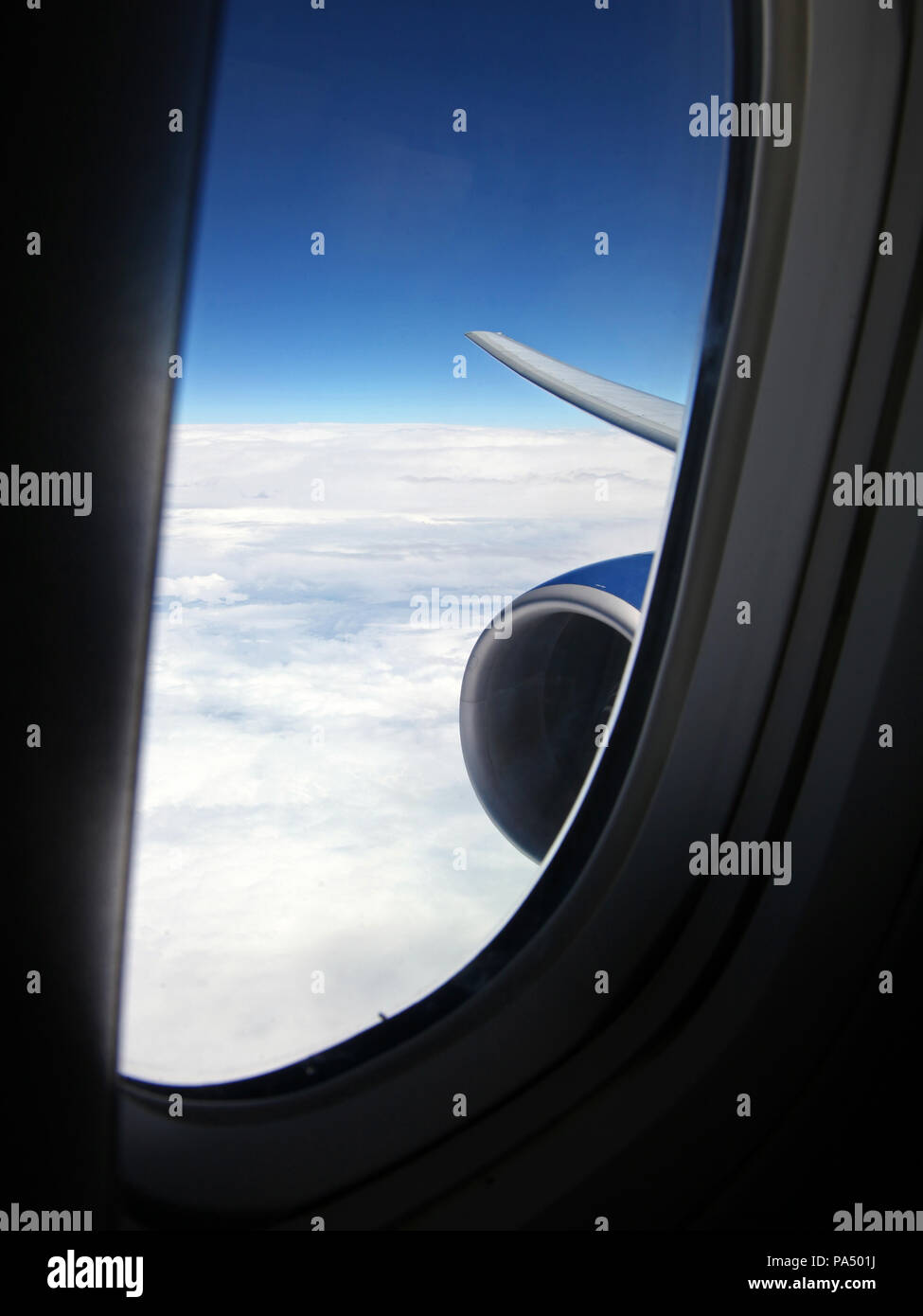 view from a Bowing jet through a side window towards the wing tip Stock Photo