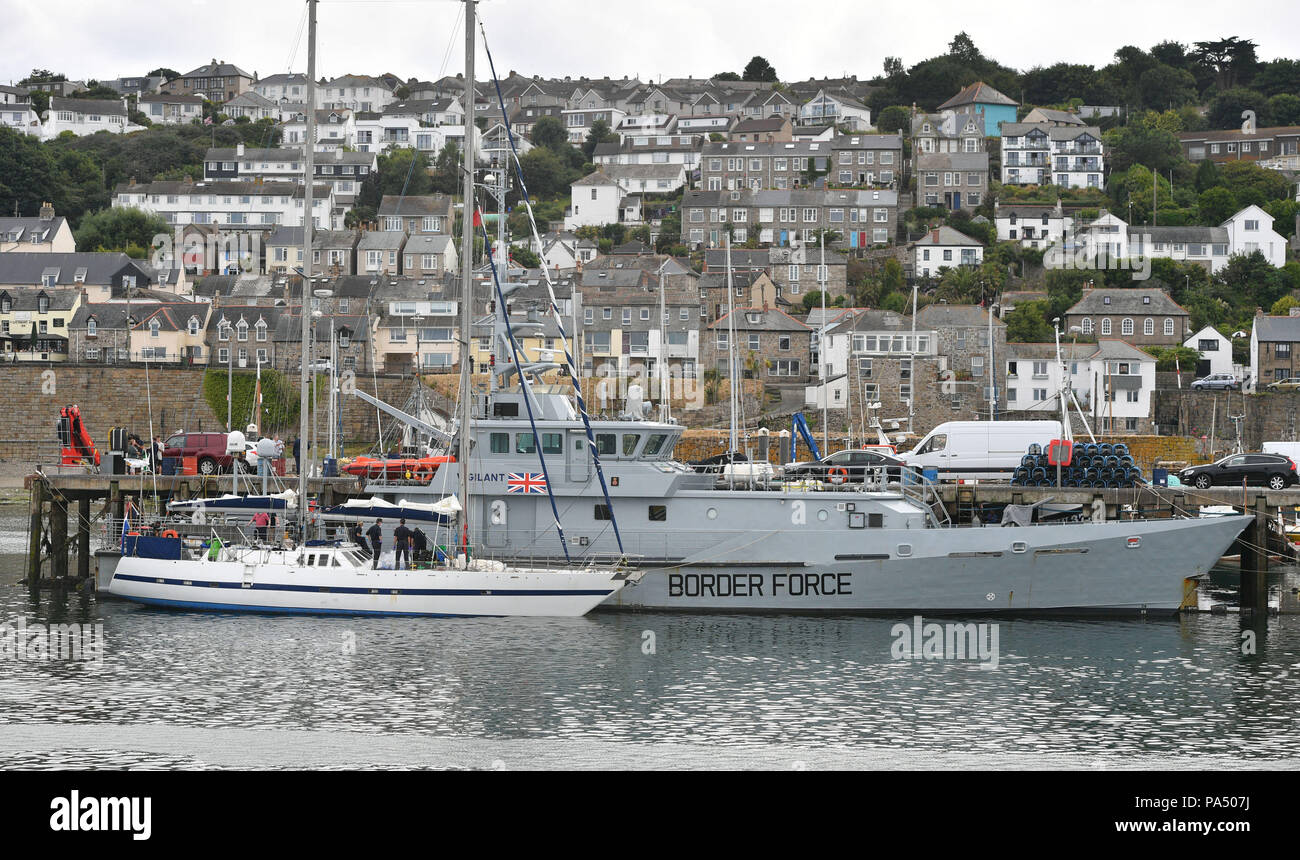 Drugs are unloaded from a boat by officers at Newlyn harbour