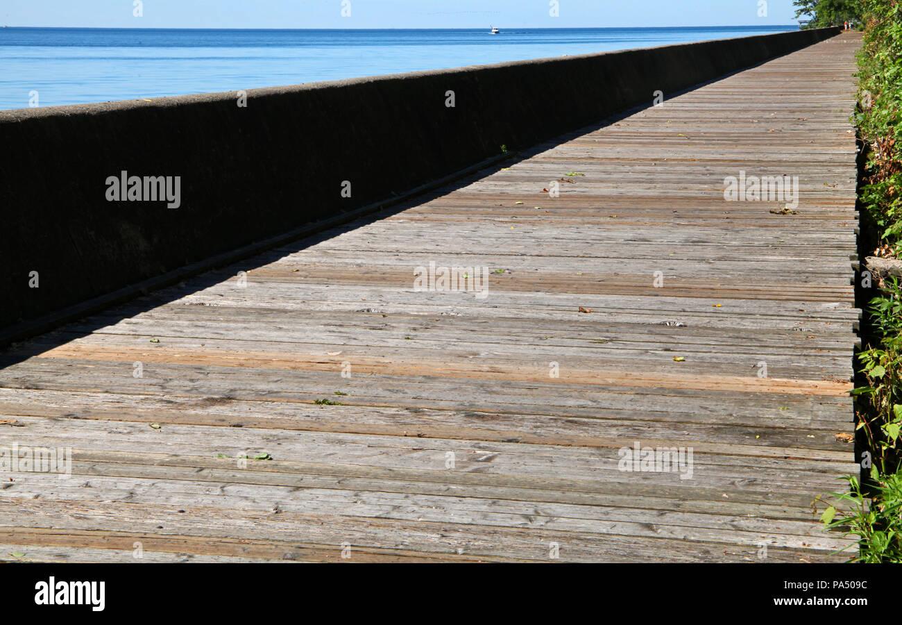 Lakeshore Avenue boardwalk on Ward's Island, Toronto Islands, Ontario, Canada - Stock Image