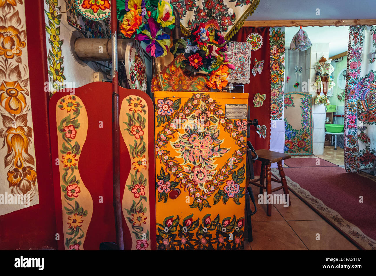 Interior of a cottage in Zalipie village in Poland, known for its local tradition of floral paintings made famous by folk artist Felicja Curylowa Stock Photo