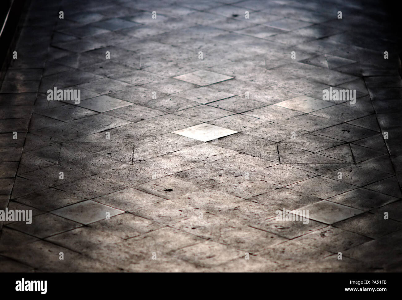 Victorian quarry floor tiles in a church aisle. - Stock Image