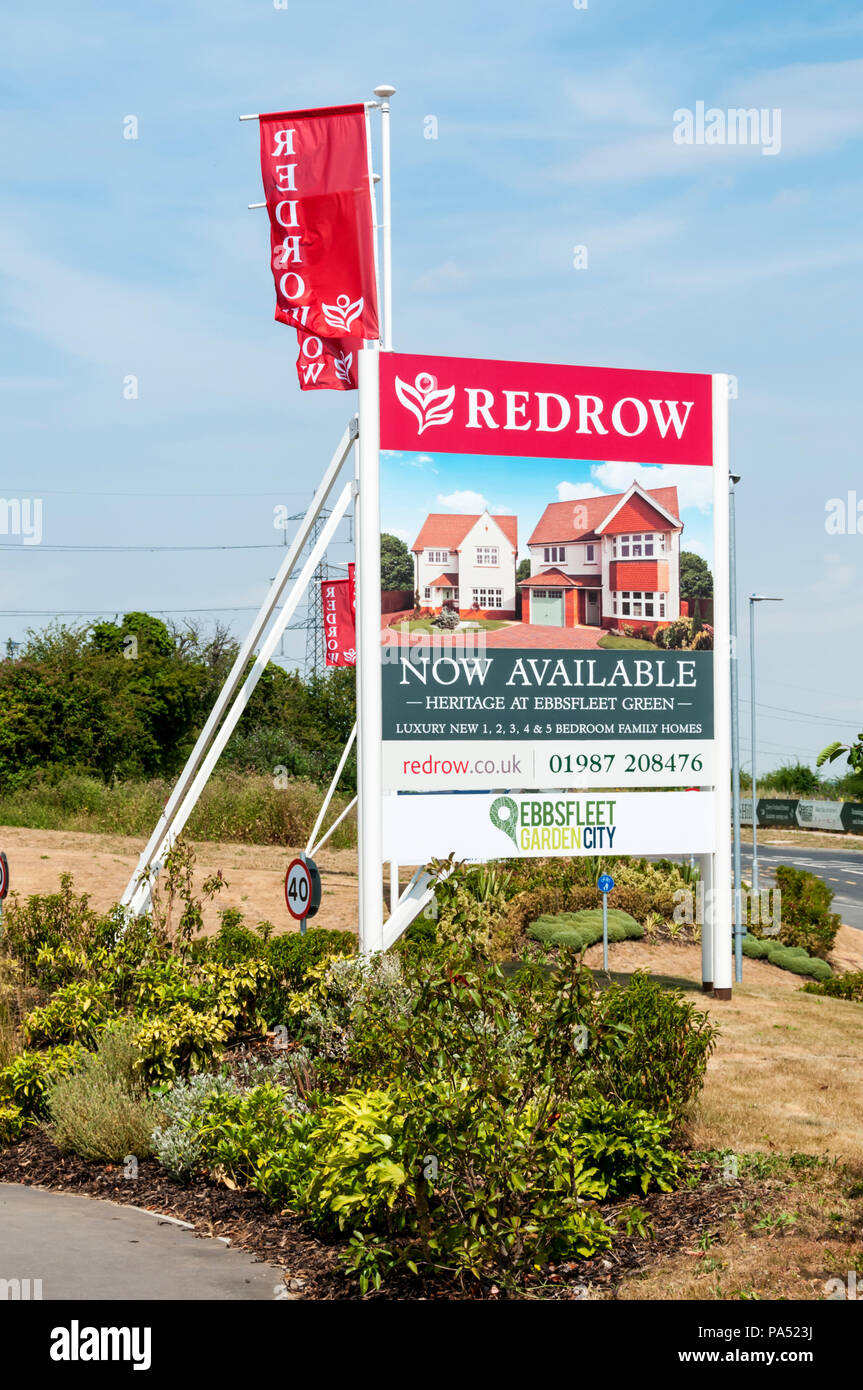A sign advertises Heritage Homes by Redrow at Ebbsfleet Green, part of Ebbsfleet Garden City in Kent. - Stock Image