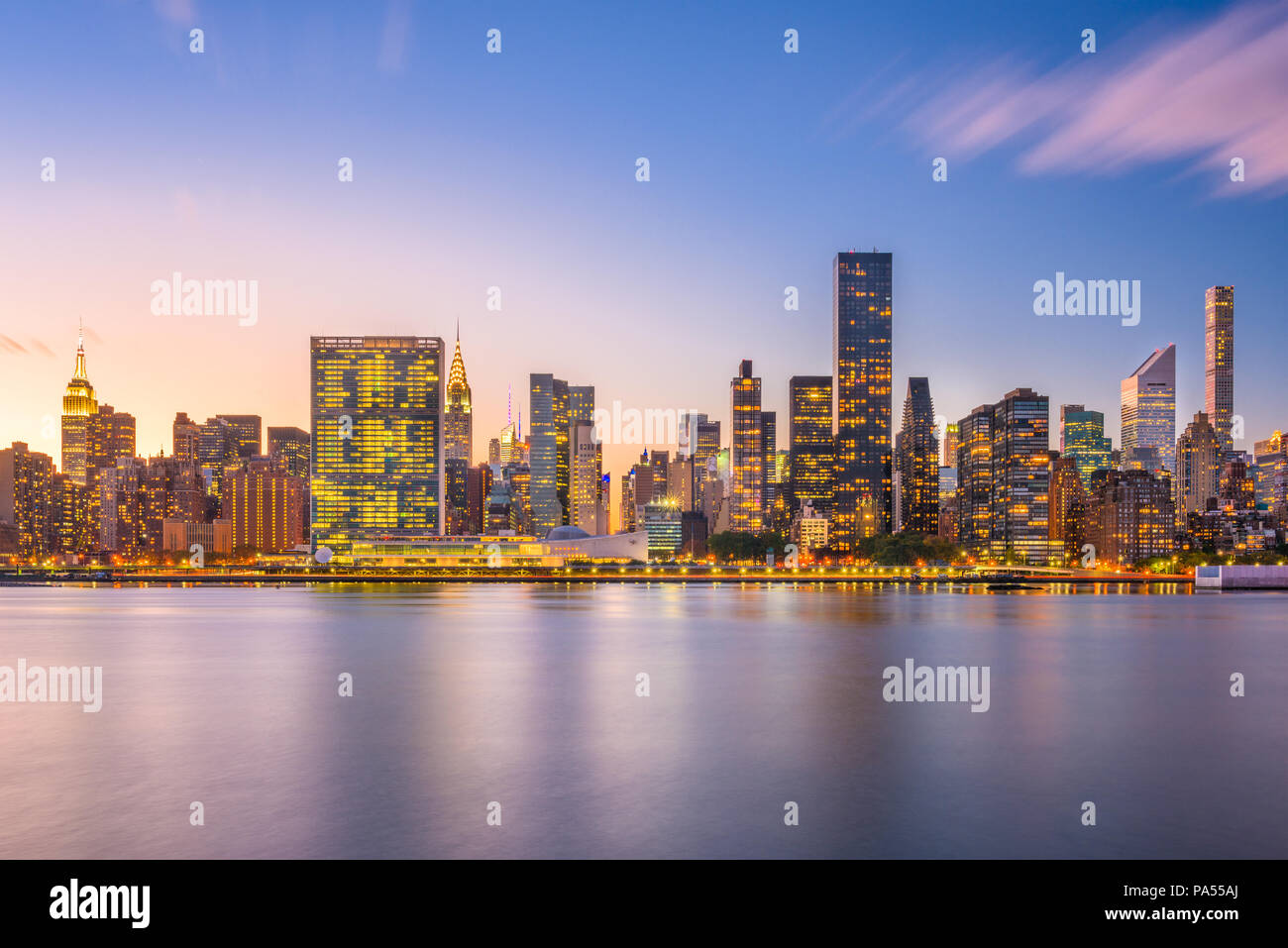 New York, New York, USA midtown skyline from across the East River at dusk. - Stock Image