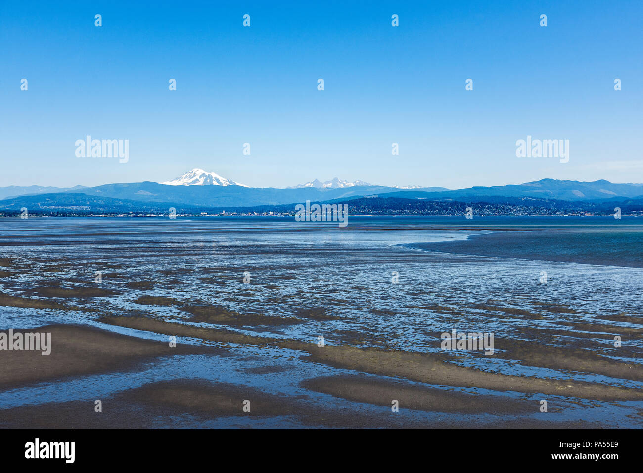 Mt. Baker and the 'Sisters' across Bellingham Bay, Bellingham, Washington, Pacific Northwest, USA. - Stock Image