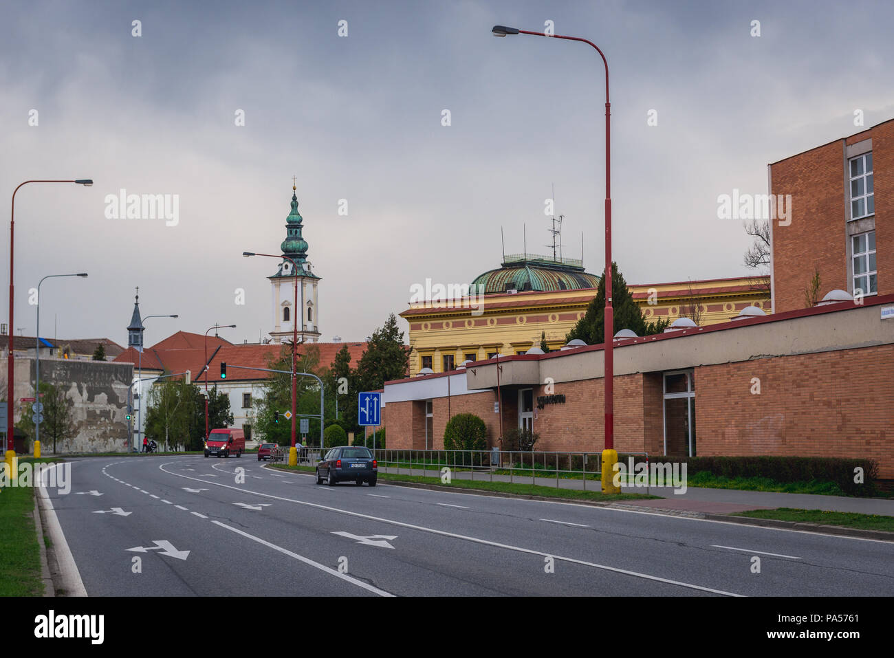 Church of the Annunciation of the Virgin Mary nad historical school building in Uherske Hradiste city in Zlin Region, Moravia in Czech Republic - Stock Image