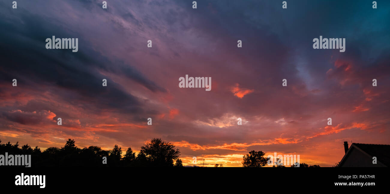 Dark sky panorama with fire colored clouds. Armageddon, judgement day conceptual background - Stock Image