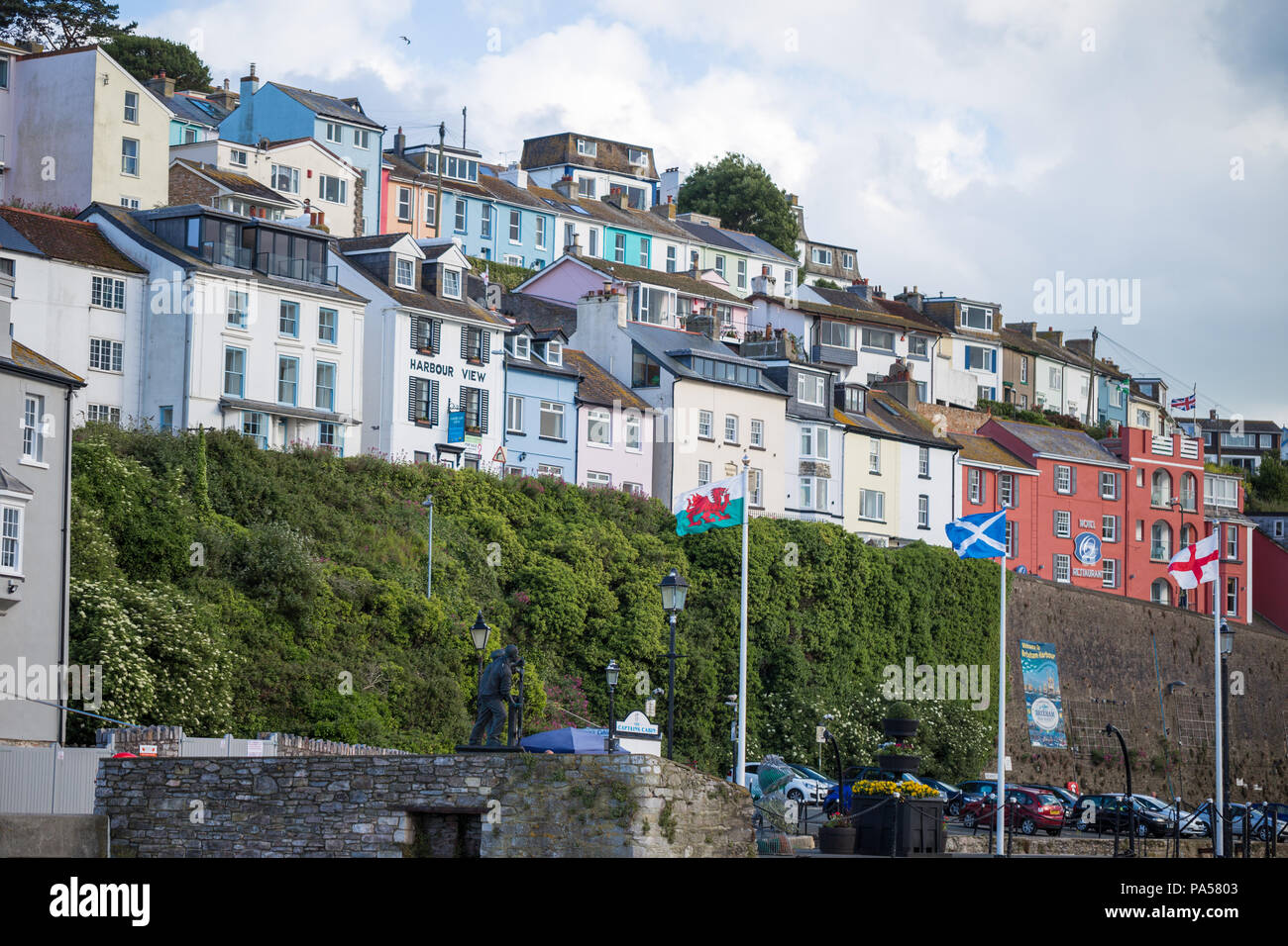 Colourful seaside home / houses with UK flags, Brixham, Devon - Stock Image