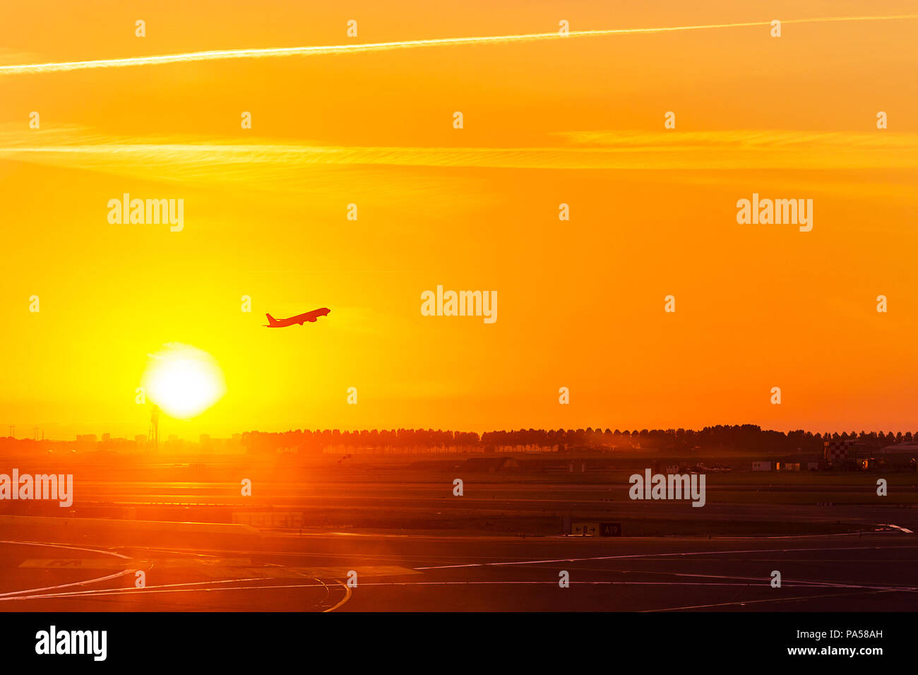 Silhouette of aeroplane, plane, take off on air at sunset time with all passenger on board for travel and for business at airport, with copy space - Stock Image