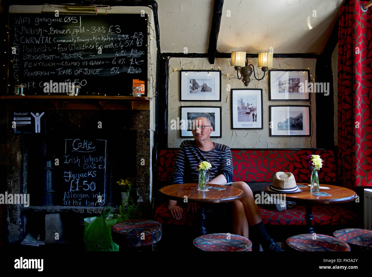 Middle-aged man in the Fox & Goose pub, Hebden Bridge, Calderdale, West Yorkshire, England UK - Stock Image