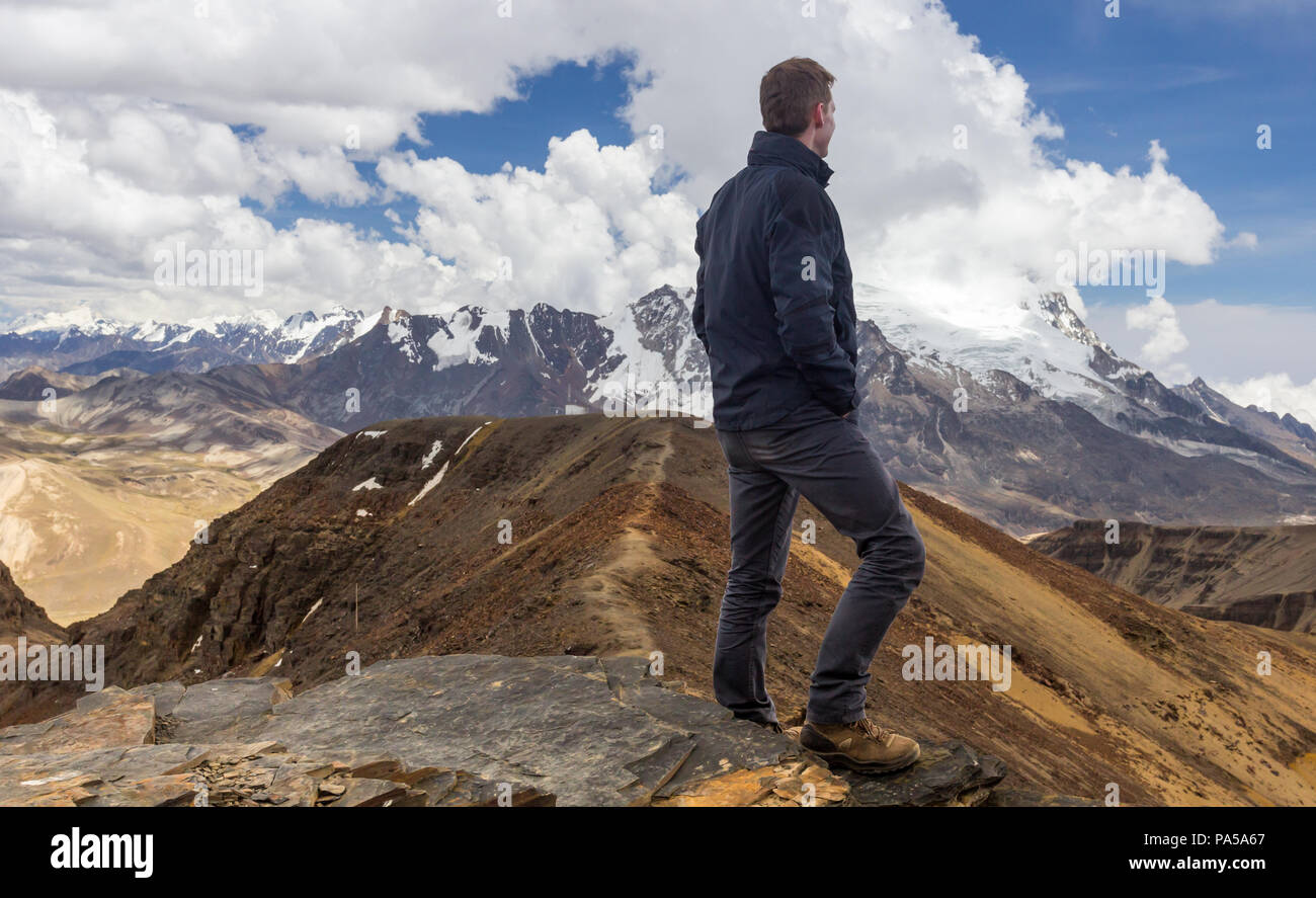 Hiker atop chacaltaya mountain in bolivia - Stock Image