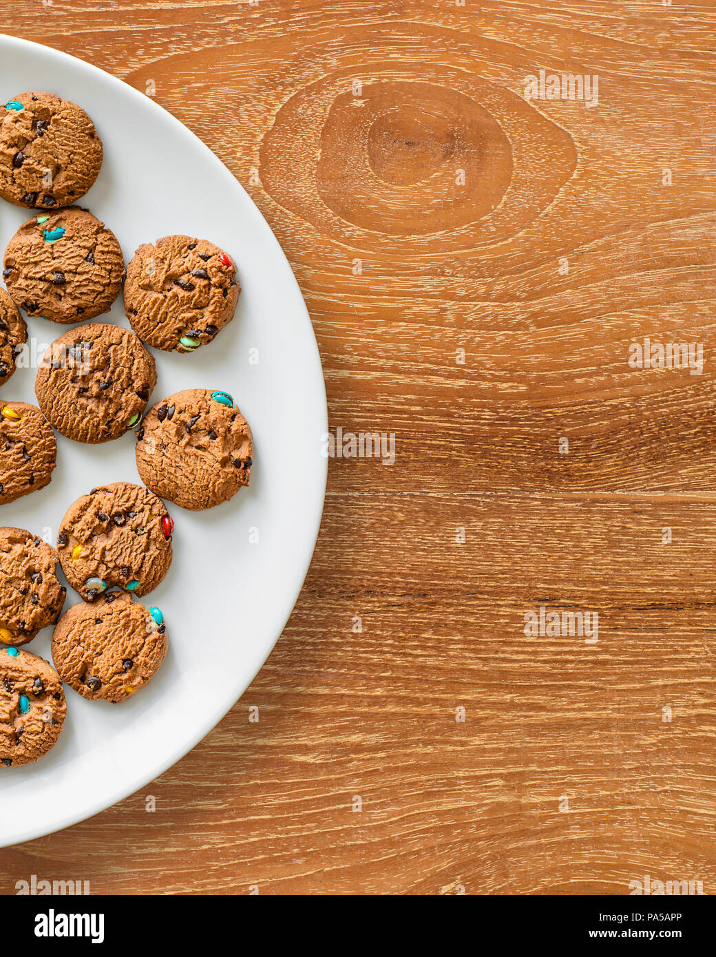 Lay flat photo of cookies on white plate. Stock Photo