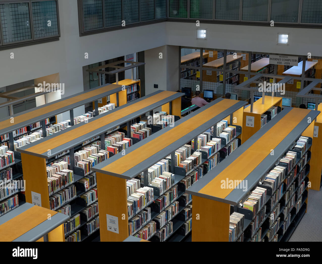 Rows of books among the stacks in the San Francisco Public Library Civic Center location - Stock Image