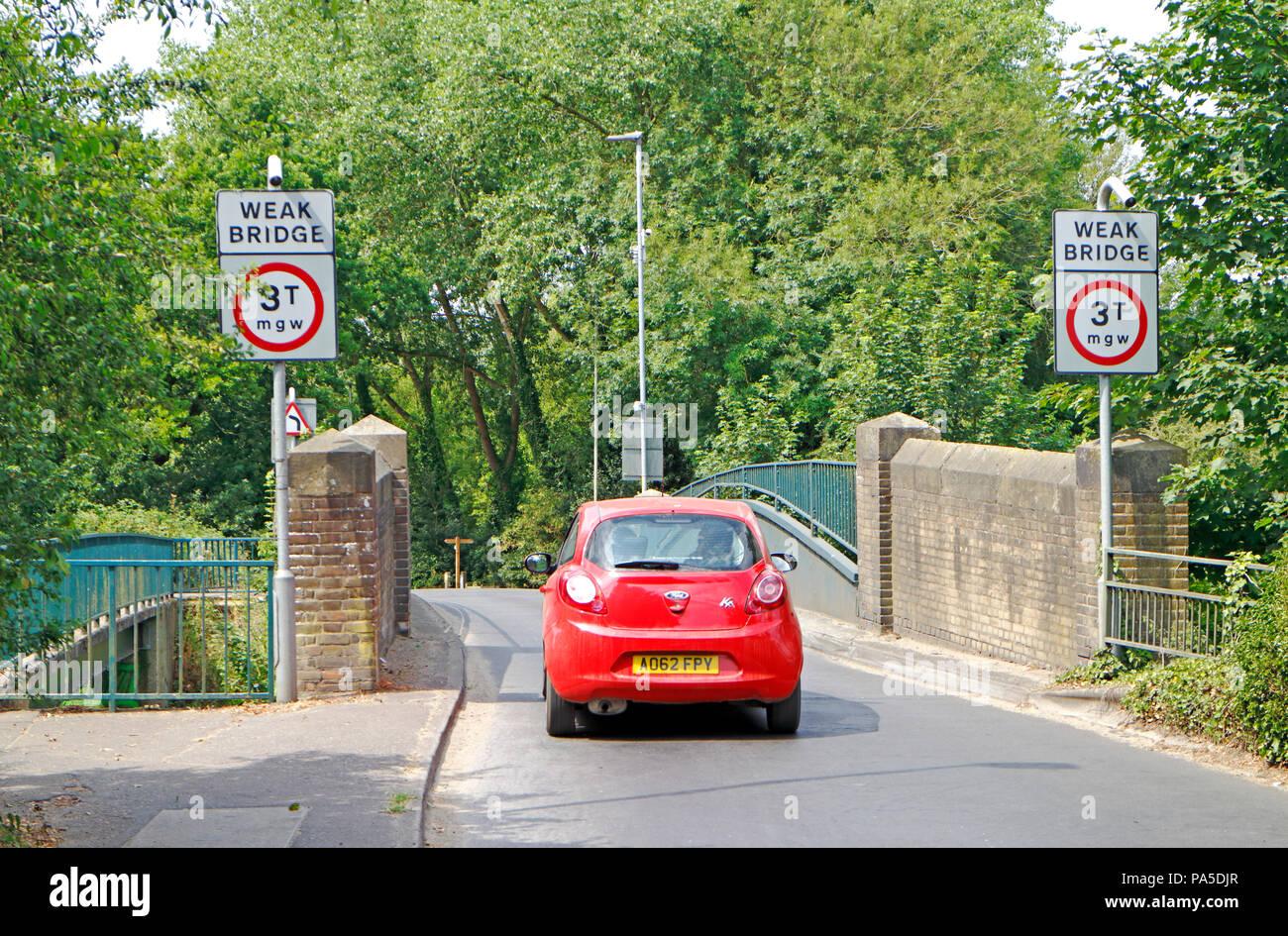 The single track Hellesdon Road Bridge crossing the River Wensum in Hellesdon, Norfolk, England, United Kingdom, Europe. - Stock Image