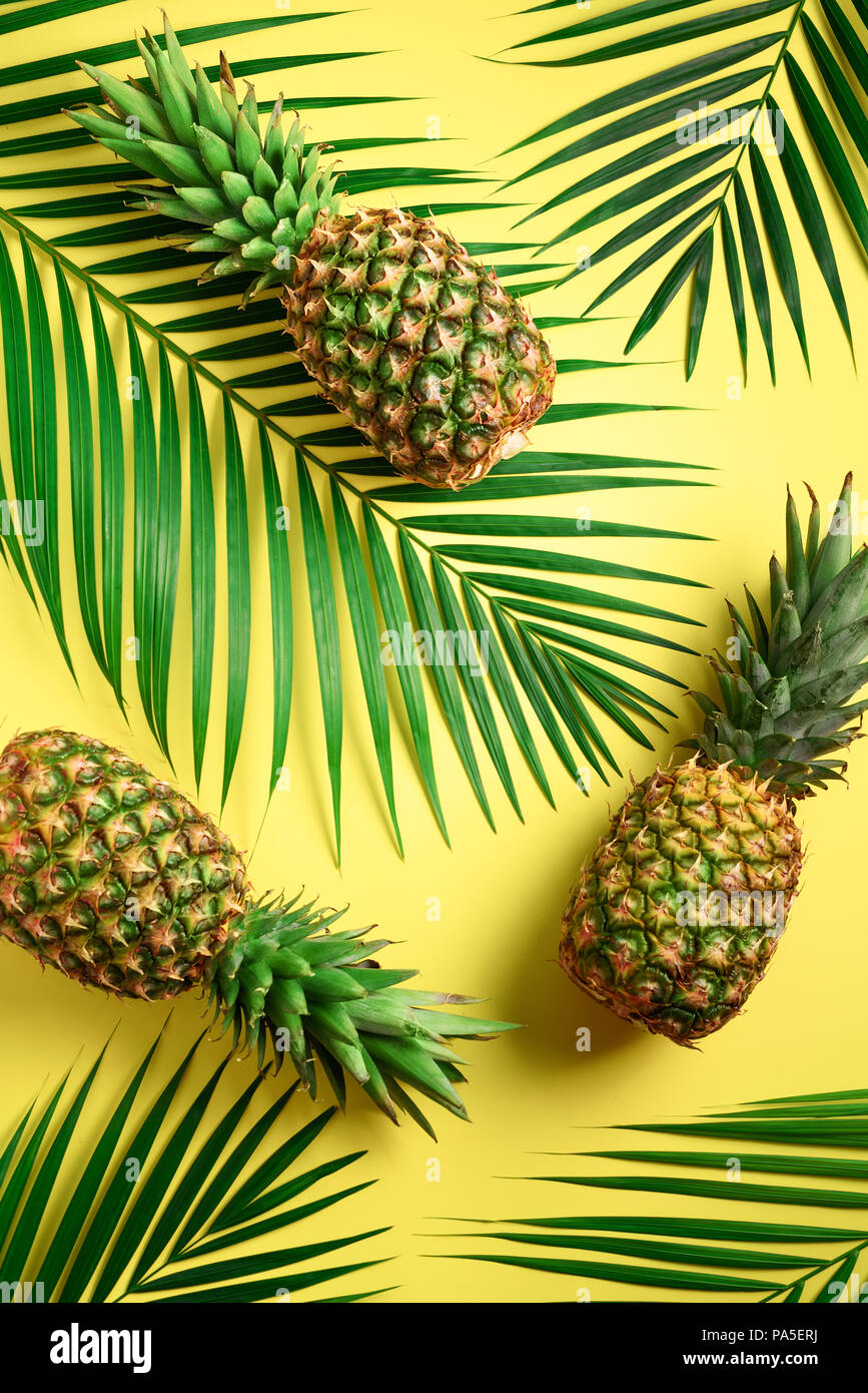 Pineapple And Tropical Palm Leaves On Yellow Background Top View Summer Concept Creative Flat Lay With Copy Space Stock Photo Alamy Check out our tropical leaves background selection for the very best in unique or custom, handmade pieces from our craft supplies & tools shops. https www alamy com pineapple and tropical palm leaves on yellow background top view summer concept creative flat lay with copy space image212792374 html