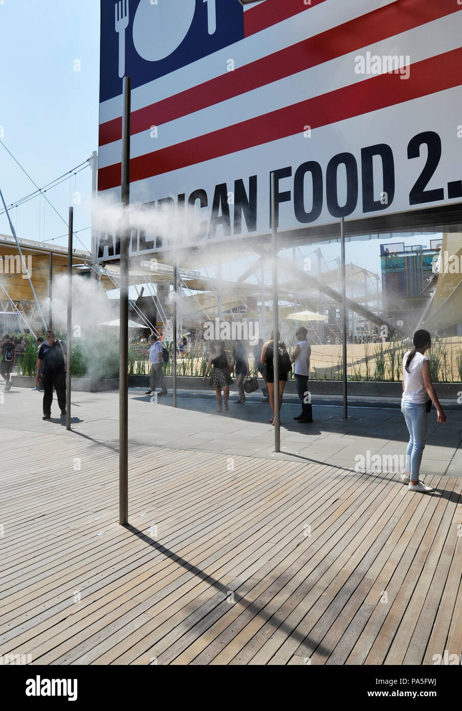 MILAN, ITALY – 06 30 2015:  An example of the use of vaporized water jets, used to refresh people during the hottest hours of the day in visiting plac - Stock Image