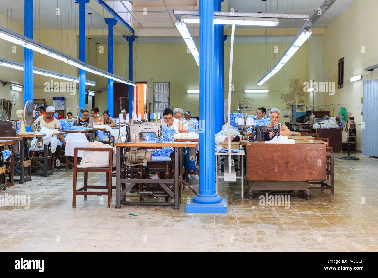 Cuban women sewing on machines in a textile production line and factory, Havana, Cuba - Stock Image