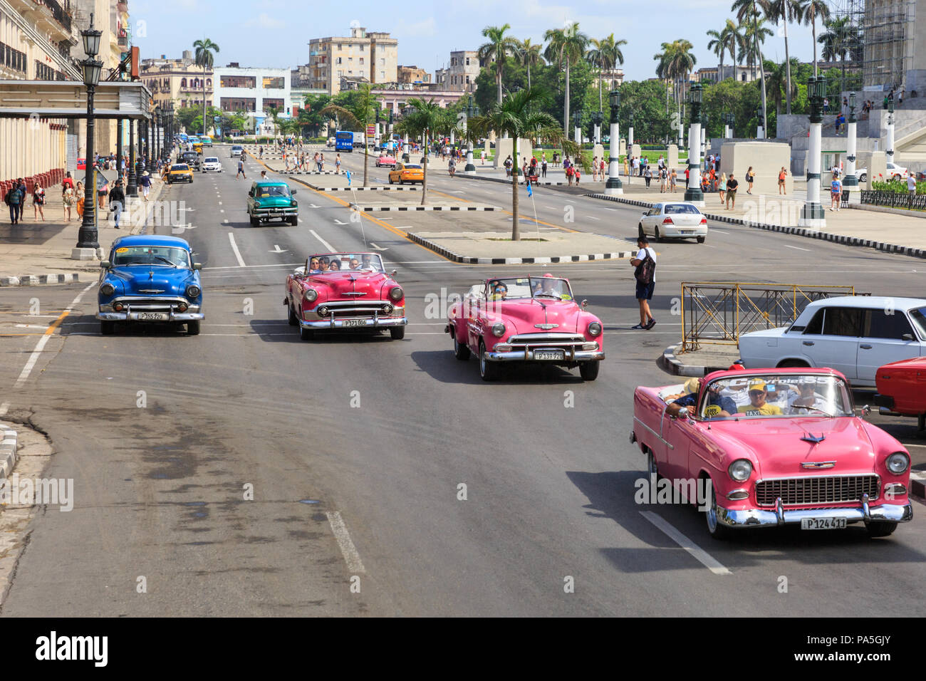 American classic cars, vintage taxies carrying tourists and visitors on Paseo de Marti in Havana, Cuba - Stock Image