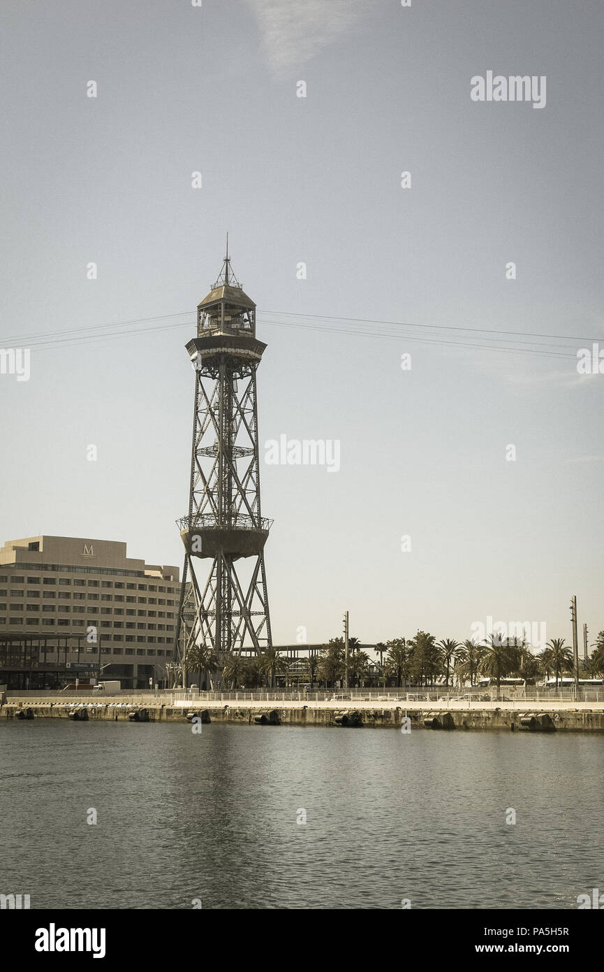 the port of Barcelona, at the end of the Ramblas. In the photo, the World trade center building and cable way tower in port of Barcelona, Catalonia - Stock Image