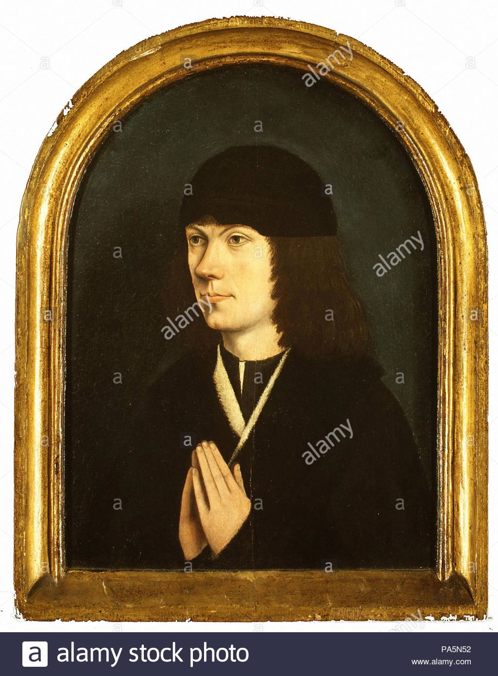 Portrait of a Young Man, Oil on wood, Overall, with arched top and engaged frame, 13 x 10 1/8 in. (33 x 25.7 cm); painted surface 10 5/8 x 8 in. (27 x 20.3 cm), Paintings, French (Burgundian?) Painter (ca. 1495). - Stock Image